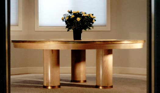 A huge round birdseye veneer table, with gold leaf and Lazy Susan