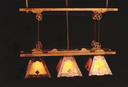 A copper, cherry and mica dining table chandilier