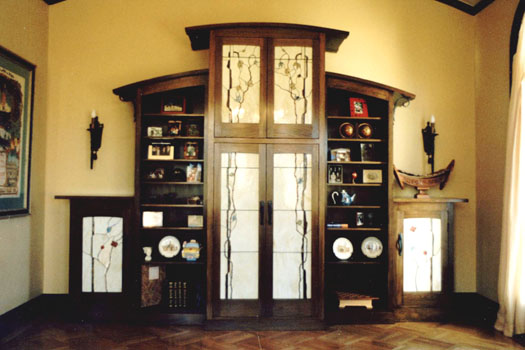 A 5 piece fumed white oak, stained glass and wrought iron wall unit